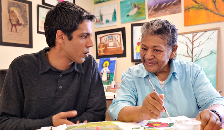 Student speaks with older adult