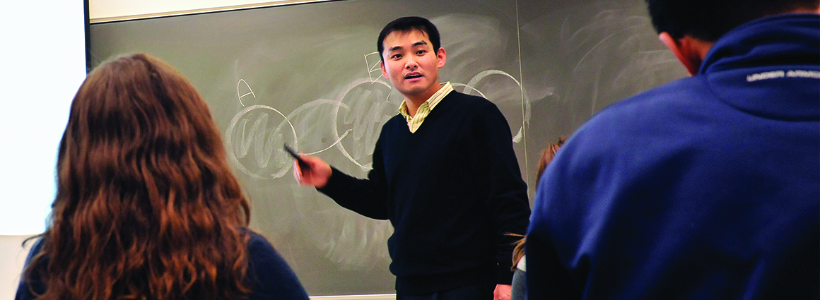 Professor in front of a chalkboard