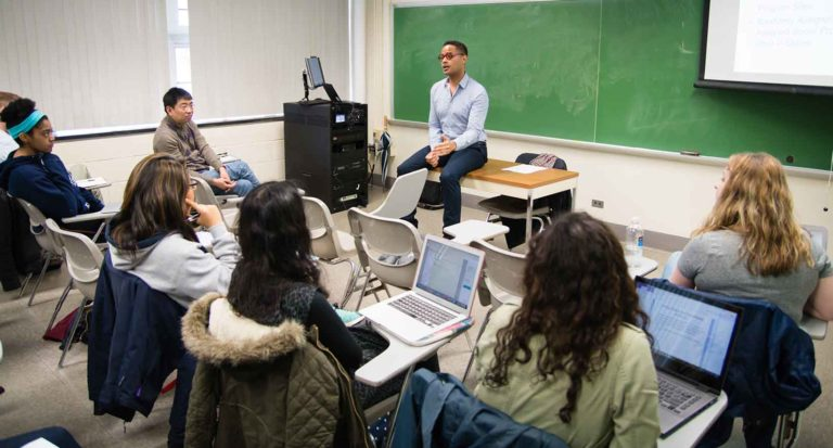 Dr. Ezekiel Dixon-Roman teaches class
