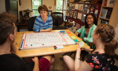 Amy Hillier working with SexGen Policy Lab interns to test out a board game that models how to discuss gender.