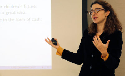 Dr. Ioana Marinescu speaking about universal basic income at an SP2 event.