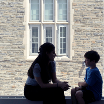 Student & child at window