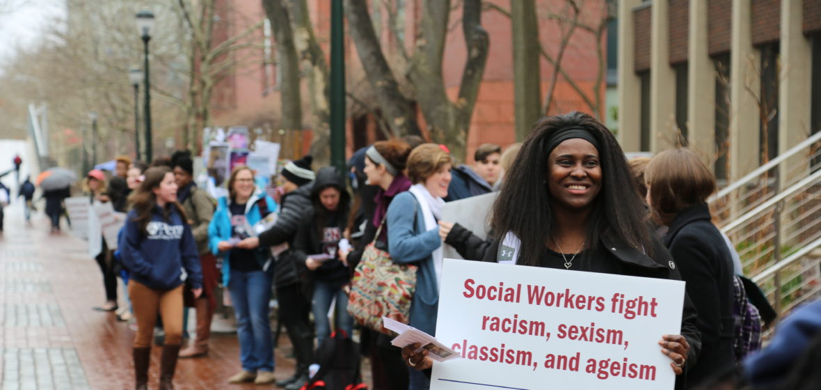 Students Hold Up Signs During The 2018 Social Work Shout Out Rally