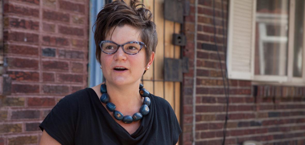 Image of Amy Castro Baker walking in South Philadelphia