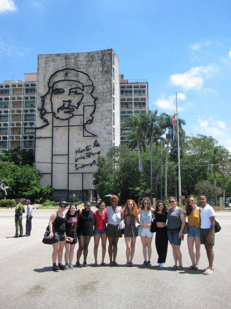 A class photo in front of an iconic hotel in Cuba