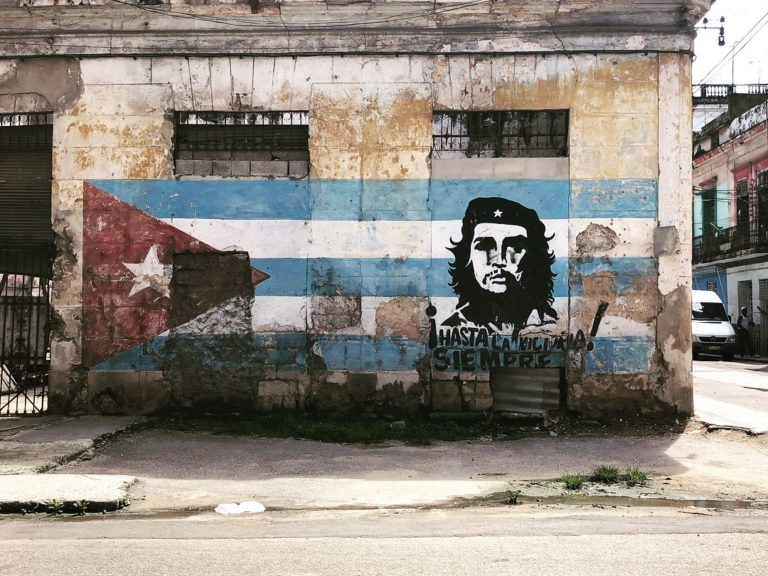 Mural and graffiti on a wall in Cuba
