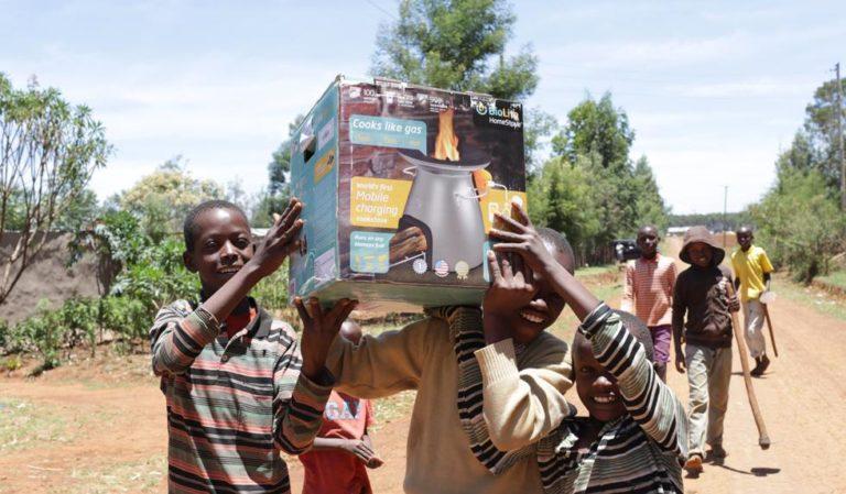 Children in Kenya holding up a BioLite stove