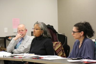 Task Force meeting in session, including Jerri Bourjolly and Mark Stern
