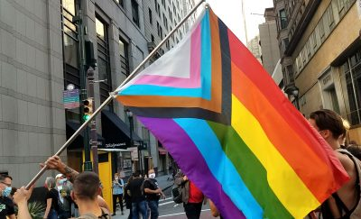 Philadelphians celebrate the outcome of 2020's presidential election, waving the Progress Pride Flag while marching through Center City.